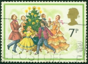 14334223-united-kingdom--circa-1978-a-stamp-printed-in-england-shows-carolers-around-christmas-tree-circa-197